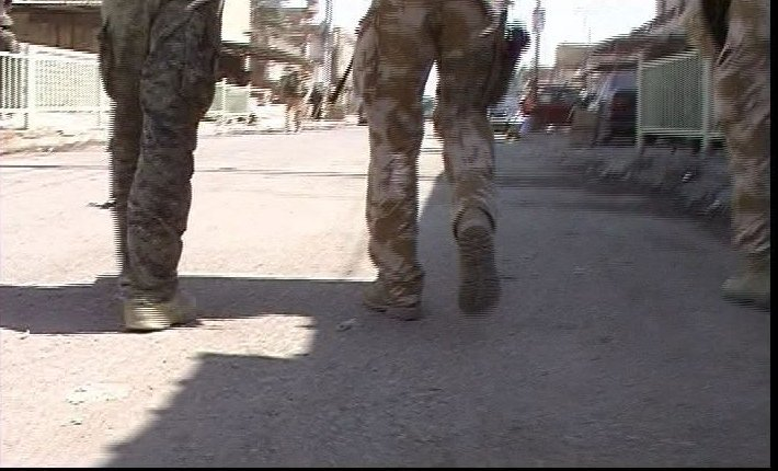 A simple sequence: shot 1, soldiers feet walking from behind
